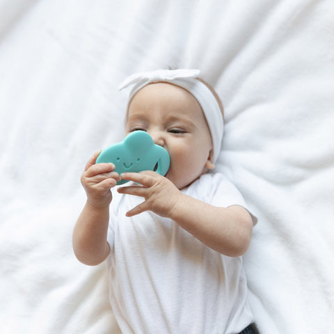 baby with whale teether