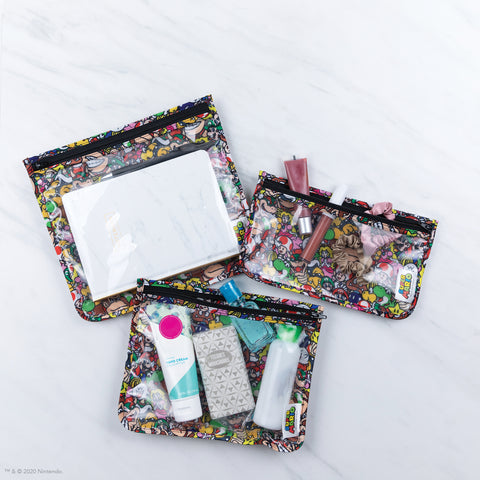 clear travel bags with mario print fabric on back holding travel  toiletries