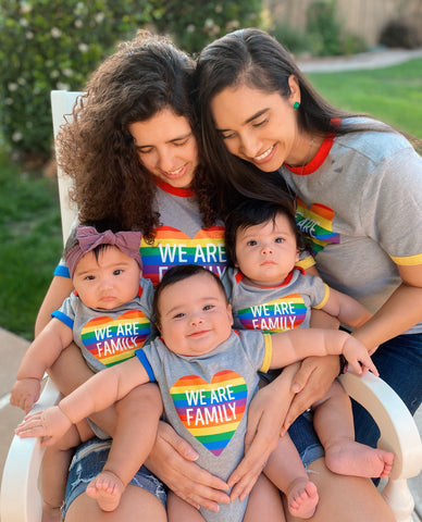 moms with their triplets in rainbow tees