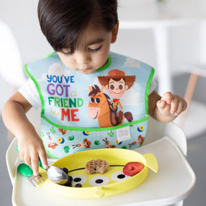 toddler eating out of alien toy story plate