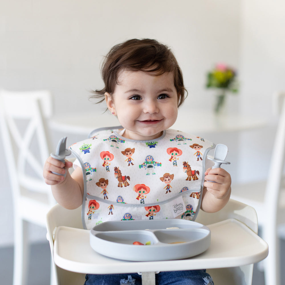 toddler in a toy story bib