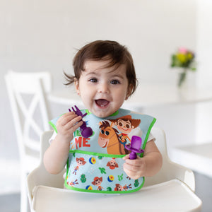 happy child in woody toy story bib