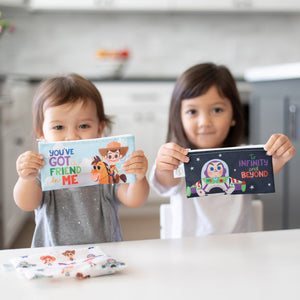 kids holding toy story small snack bags