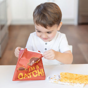 boy with harry potter snack bag