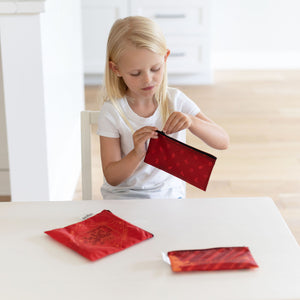 girl unzipping a harry potter snack bag