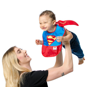 woman lifting baby in a superman bib