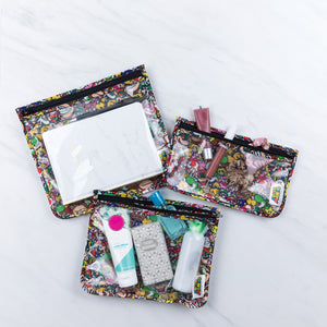 tsa clear travel bags with cosmetics and travel size products in super mario print