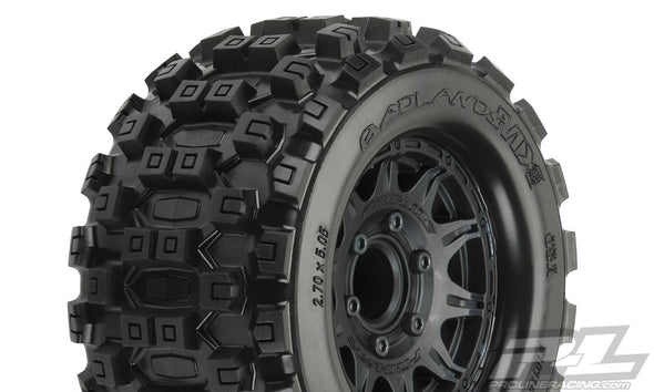 "10125-10 Badlands MX28 2.8"" All Terrain Tires Mounted on Raid Black 6x30 Removable Hex Wheels (2) for Stampede® 2wd & 4wd Front and Rear"