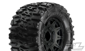 "1170-10 | Trencher 2.8"" All Terrain Tires Mounted on Raid Black 6x30 Removable Hex Wheels (2) for Stampede® 2wd & 4wd Front and Rear"