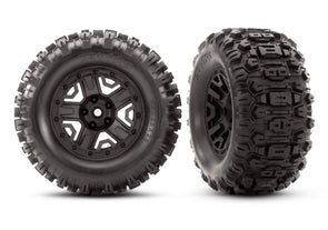 "6792 Traxxas Tires & wheels, black, 2.8"" / Sledgehammer wheel"
