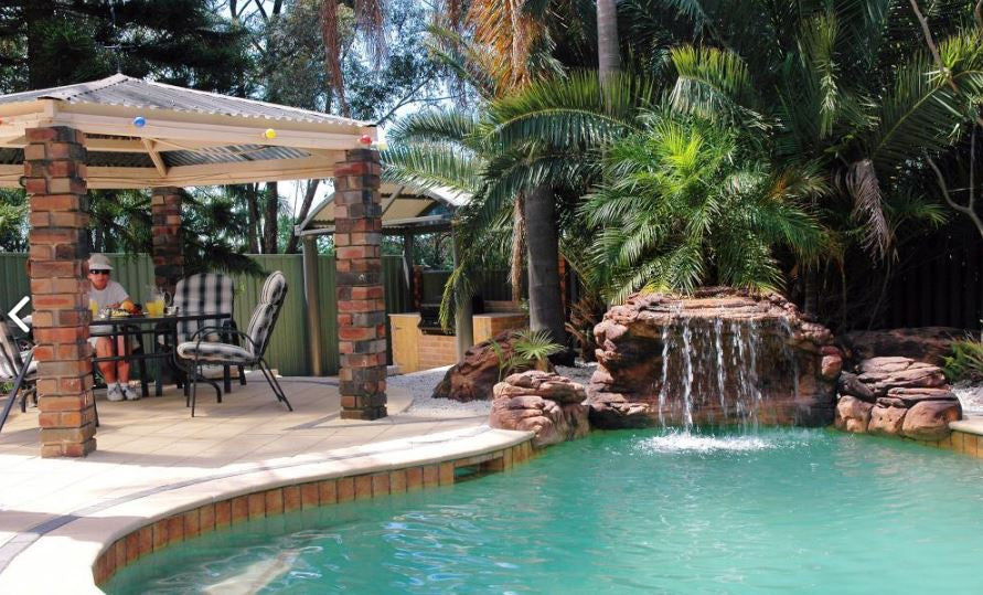 Photo of The Oasis - Swimming Pool Waterfall - PCAVE-004 by Universal Rocks  - Marquis Gardens