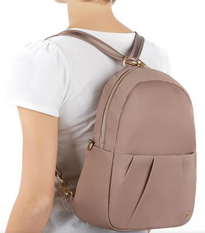 woman wearing pacsafe citysafe 8 litre convertible backpack