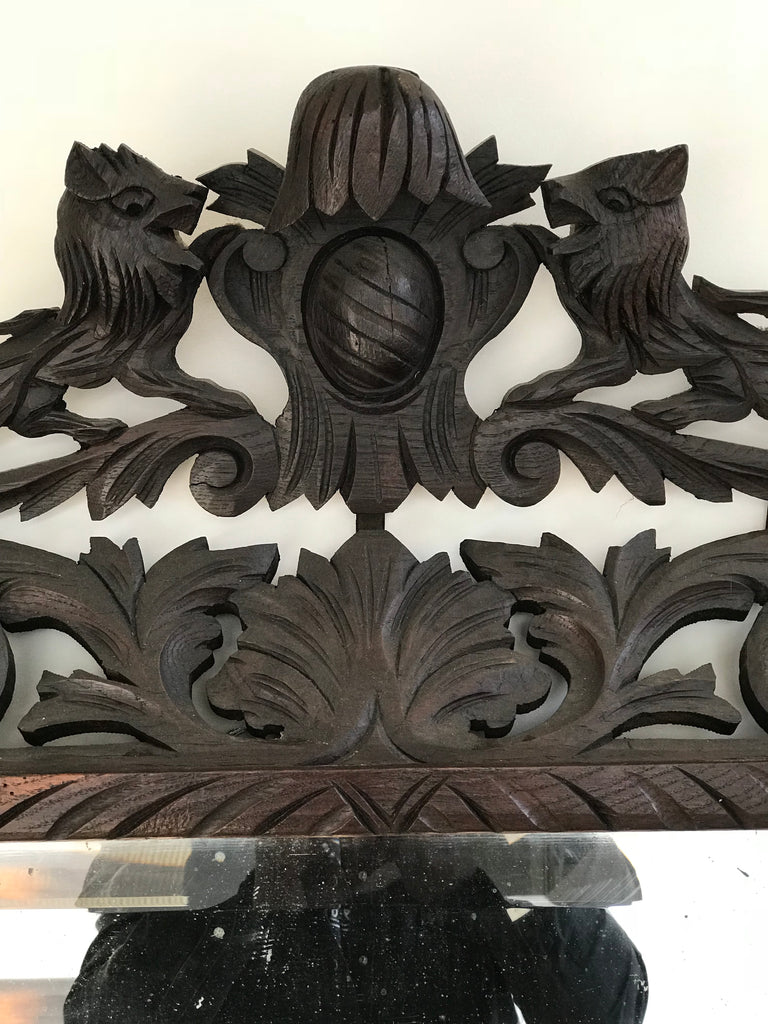 Hand carved crest mirror