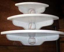 Corner shelves with baseballs