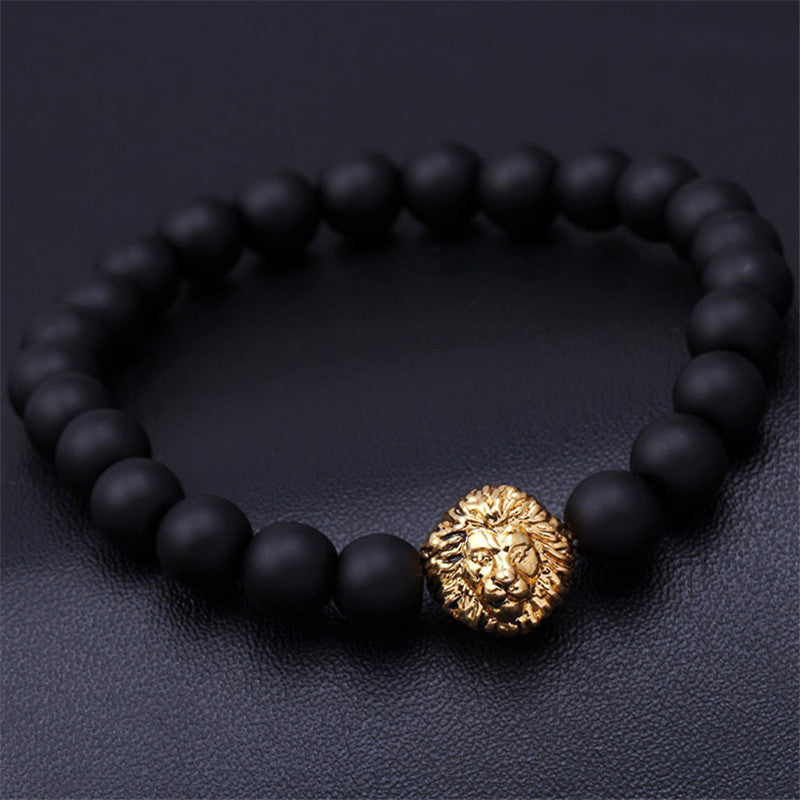 black bead bracelet with gold lion pendant