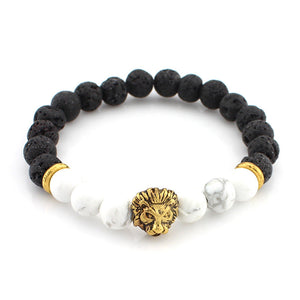 black and white bead bracelet with gold lion head pendant