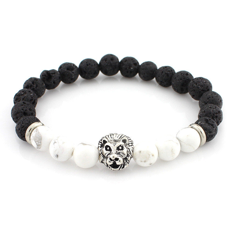 black and white bead bracelet with silver lion head pendant