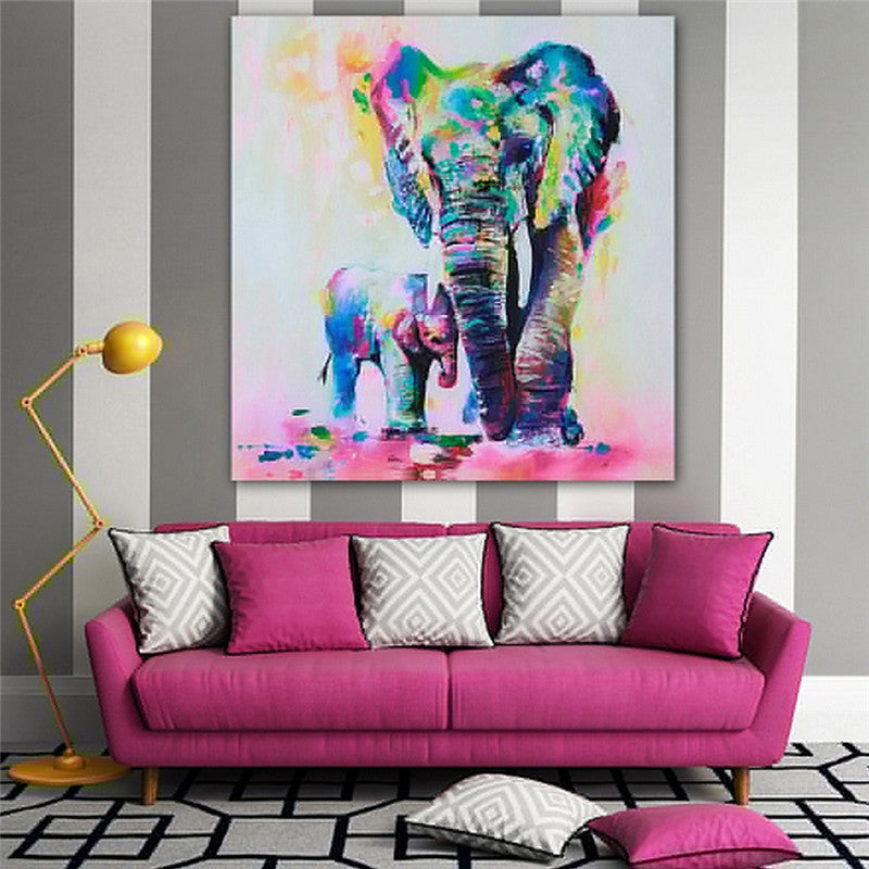 elephant painting canvas hanging in living room with pink couch