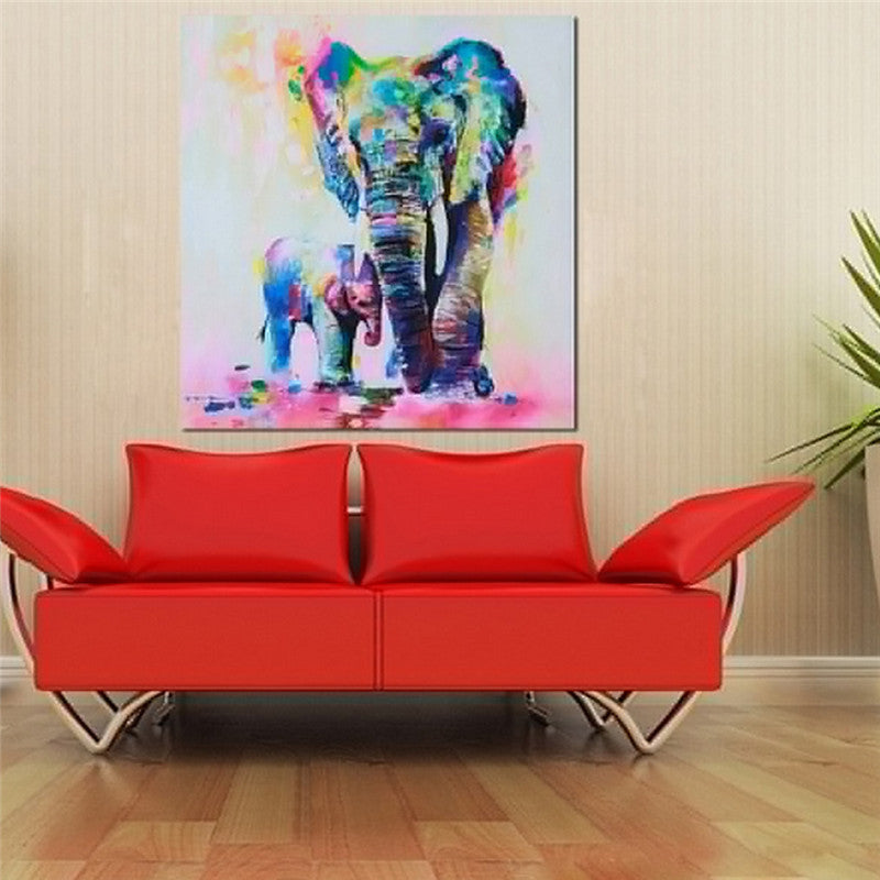 elephant painting canvas hanging in living room with red couch
