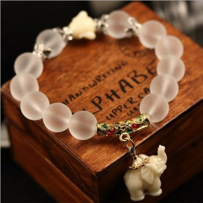 clear bead bracelet with elephant pendant and wooden box
