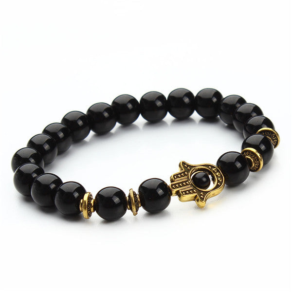 black bead bracelet with gold pendant