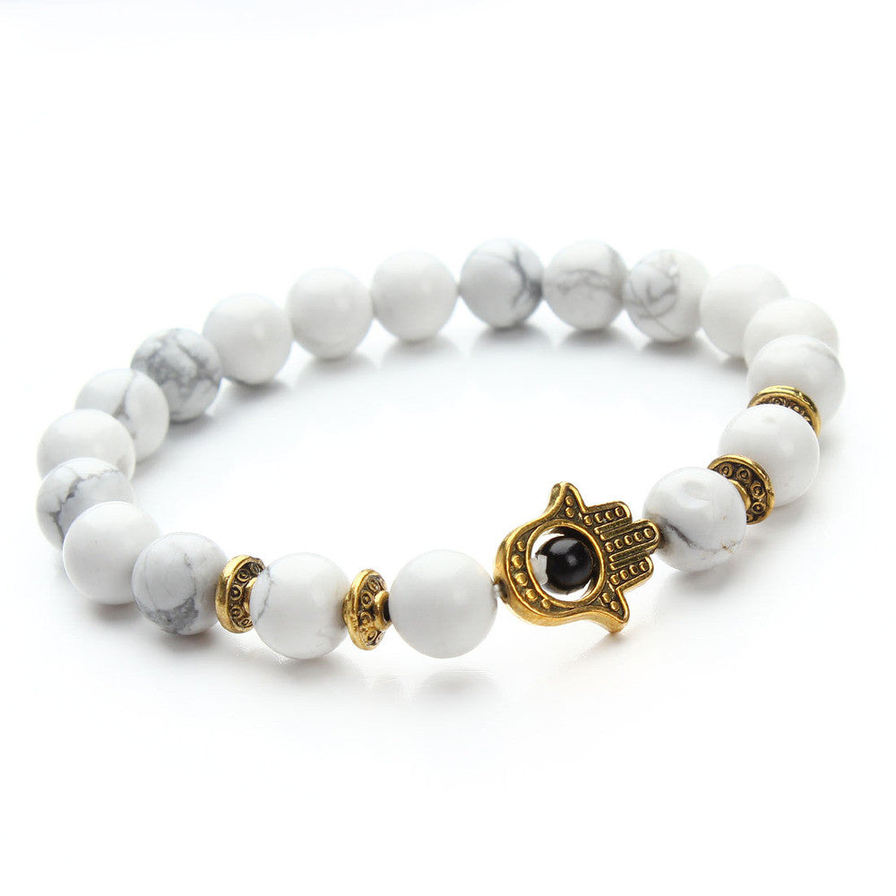 white bead bracelet with gold pendant
