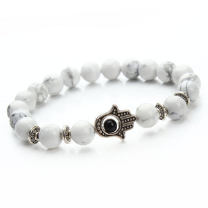 white bead bracelet with black pendant