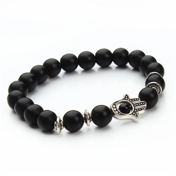 black bead bracelet with silver pendant