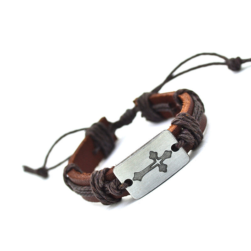 brown leather bracelet with crucifix pendant