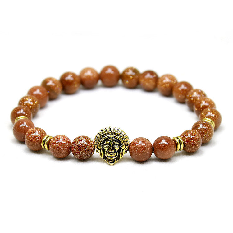 orange bead bracelet with gold indian head pendant