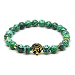 green bead bracelet with gold indian head pendant