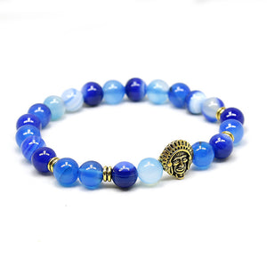 blue bead bracelet with gold indian head pendant