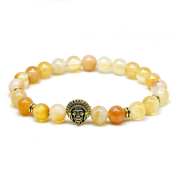 yellow bead bracelet with gold indian head pendant