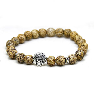 gold bead bracelet with silver indian head pendant