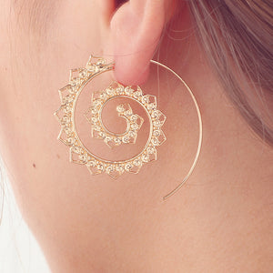 woman wearing gold spiral earring