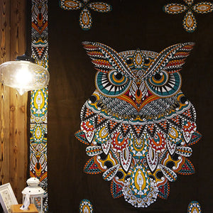 owl mandala with light fixture in background