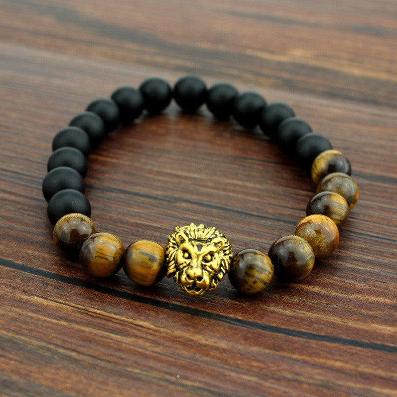 brown and black bead bracelet with gold lion head pendant