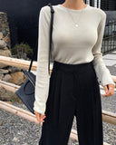 BUTTONED SLEEVE KNIT