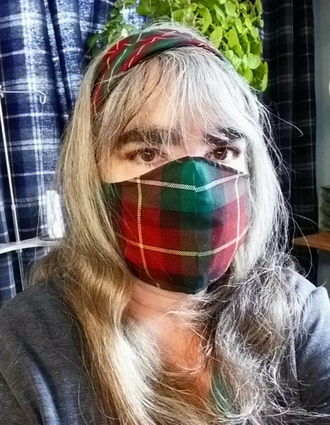 Woman wearing PEI tartan mask and matching headband