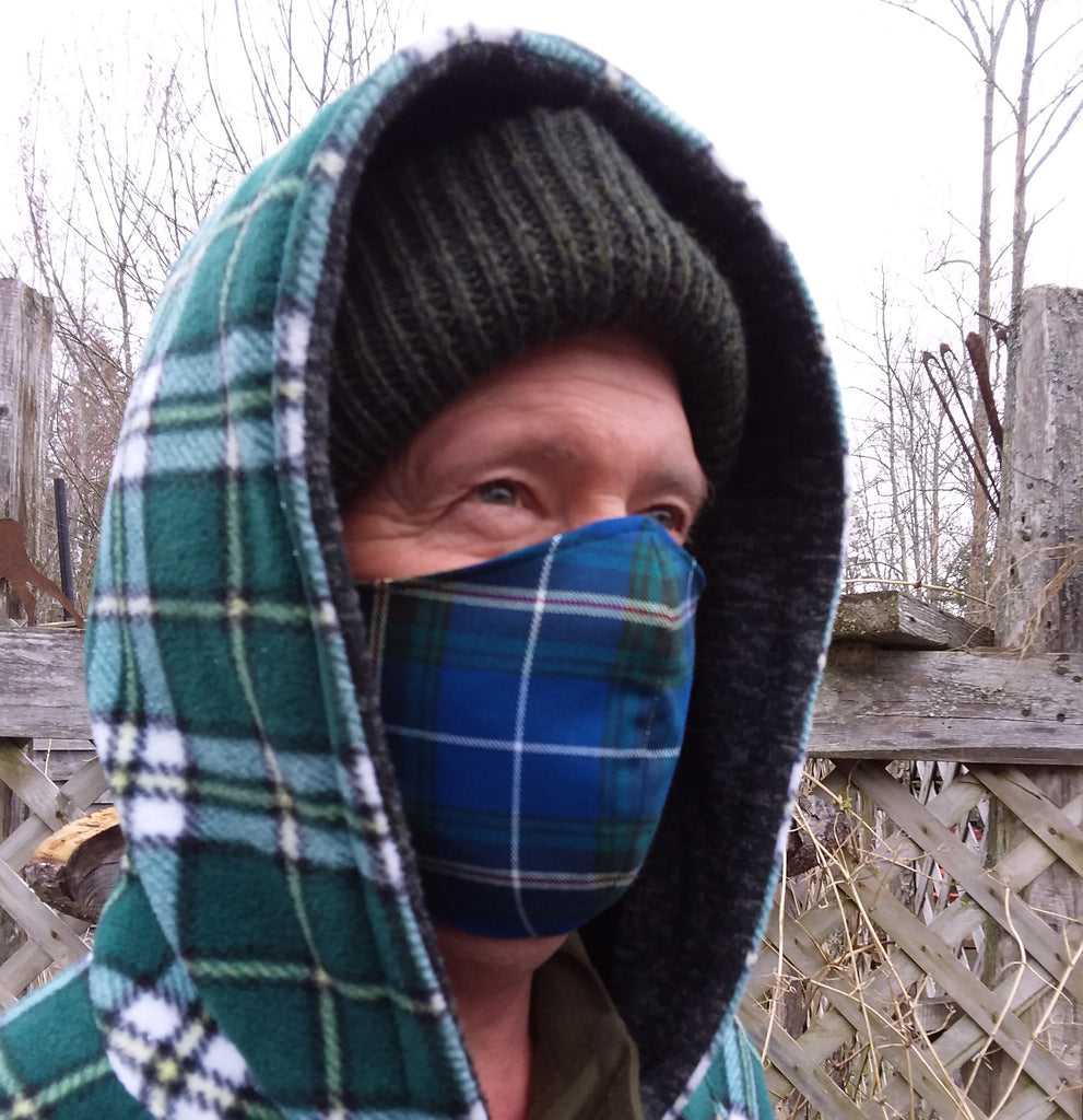 Man wearing Nova Scotia tartan mask with Cape Breton tartan jacket