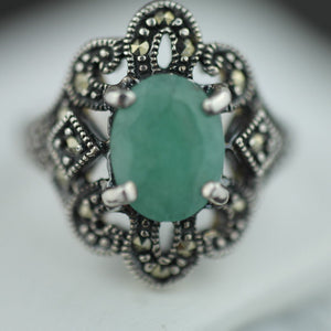 Vintage sterling silver ring with green emerald and marcasite
