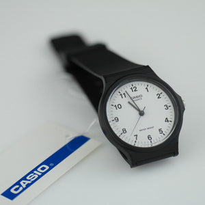 Casio unisex classic wrist watch white dial Arabic numerals black case MQ-24-7BL