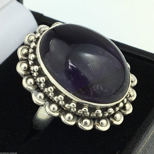 Stylish solid silver ring with cabochon purple amethyst gemstone from India