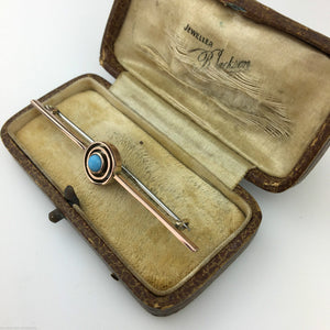 Antique 9ct gold pin bar brooch with turquoise gemstone eye from British Empire