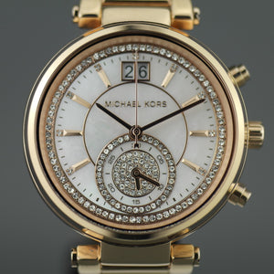 Michael Kors Sawyer Swiss made Gold Plated Ladies wristwatch with Nacre and Crystal Pave Dial