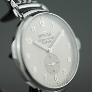 Shinola The Canfield wrist watch with sandy dunes of Michigan's grey dial