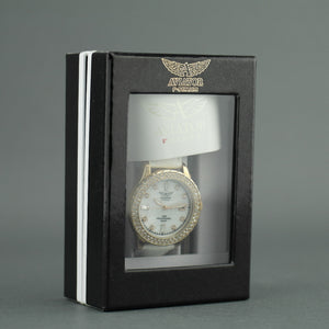 Aviator gold plated wrist watch with inlaid basel and interchangeable straps