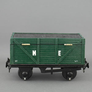 Vintage secret wooden box in shape of a train wagon full of coal