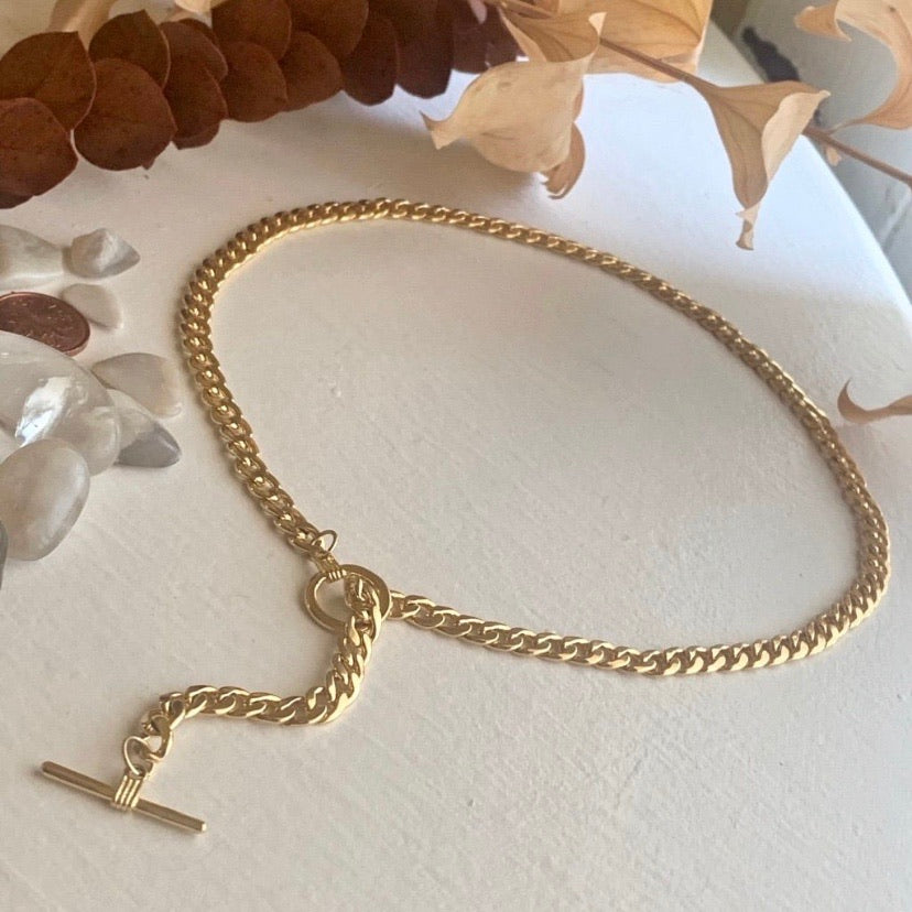 Gold chain necklace with toggle clasp