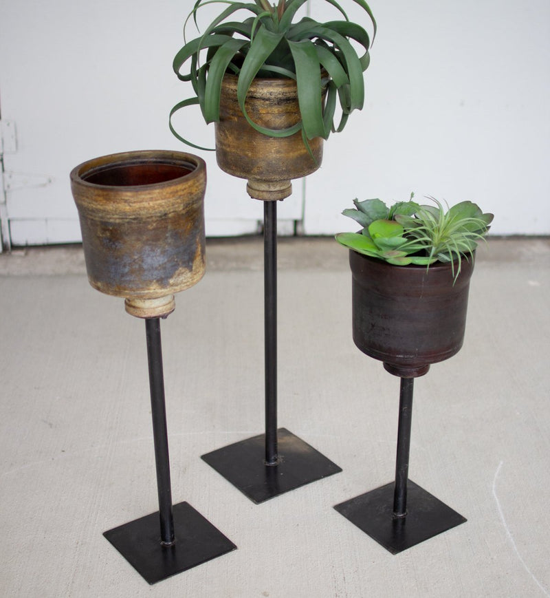 Repurposed Fiberglass Planters with Iron Stands